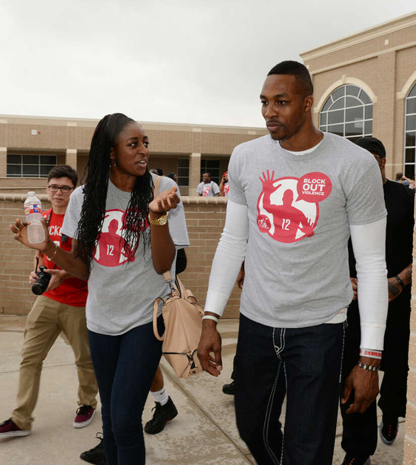 Former Cy-Fair High School and Stanford University standout basketball player Nneka Ogwumike speaks with Dwight Howard as he departs Cypress Lakes High School on Friday after the Block Party.