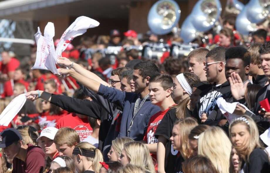 Katy students cheer against Cinco Ranch at Rhodes Stadium in Katy on Saturday, November 2, 2013.