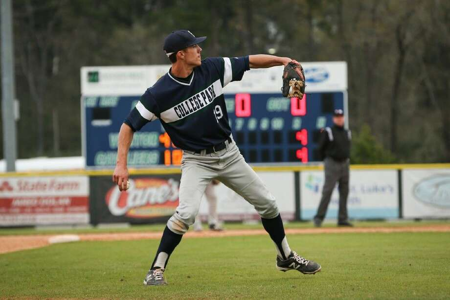 College Park's Colin Cameron throws to the pitcher's mound while warming up between innings.