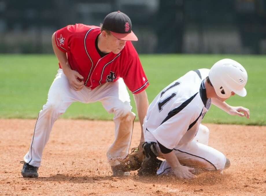 A St. John's infielder applies the tag to a Houston Christian runner during the teams' SPC South Zone clash Saturday at St. John's. The Mavericks fell by a 4-1 score to stand 1-1 in the SPC South Zone. Photo: Kevin B Long