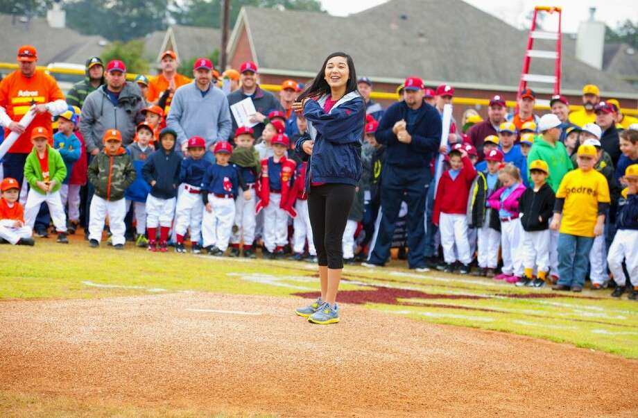 Dusti Garcia prepares to throw the first pitch on Satruday, March 7, at the Magnolia Baseball Fields in Magnolia.