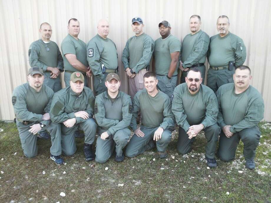 The Liberty County Sheriff's Special Response Team, commanded by Capt. Mark Ellington, is a highly-trained unit that can respond to dangerous situations, including hostage standoffs and felony arrests. Pictured are (back row, left to right) Capt. Mark Ellington, Sgt. Brett Audilet, Dana Holst (EMS), Sgt. Brian Bortz, Cpl. Josh Leal, Kelvin Burks (EMS), Craig Ringer (EMS); (front row) Sgt. Chris Ungles, Cpl. Travis Pierce, Dep. Ranson Martel, Sgt. Billy Knox, Johnny Spurlock (EMS) and Jesse McGray (EMS).