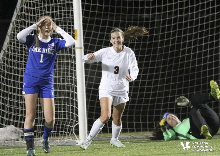 Kylie Dodson celebrates her third goal of the night to the dismay of Oak Ridge's Hailey Miller.