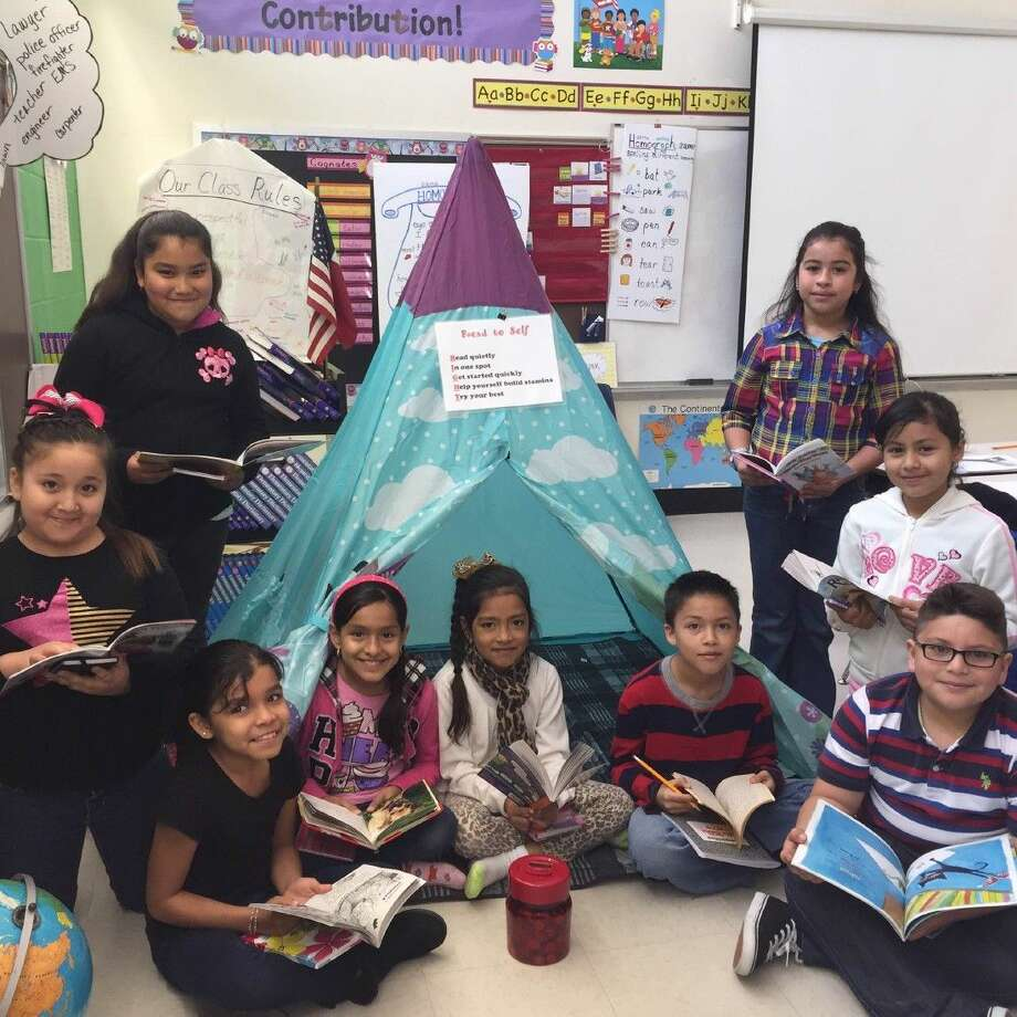 The third-grade students in Ms. Ortiz's class at Richter Elementary are super excited about the reading initiative their teacher created. Pictured are Noemi Bocanegra, Xeomara Antunez, Cynthia Lopez, Luis Treviño, Norberto Moreno III, Daniela Robledo, Fatima Lara, Citlali Colmenero and Melina Umanzor.