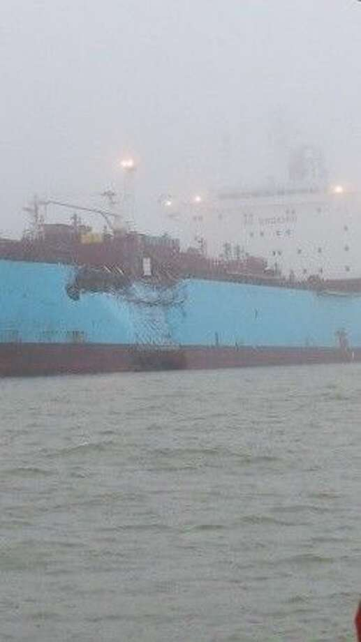 The chemical tanker Carla Maersk sits at anchor off Morgan's Point after being involved in a collision with the bulk carrier Conti Peridot March 9, 2015. The Maersk was carrying about 216,000 barrels of Methyl Tertiary Butyl Ether and an unknown quantity of the product was spilled. (U.S. Coast Guard photo by Petty Officer 3rd Class Dustin R. Williams).