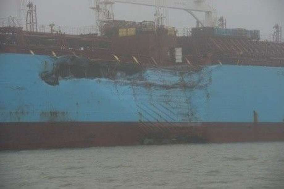 The chemical tanker Carla Maersk sits at anchor off Morgans Point, Texas, after being involved in a collision with the bulk carrier Conti Peridot March 9, 2015. The Maersk was carrying about 216,000 barrels of Methyl Tertiary Butyl Ether and an unknown quantity of the product was spilled. (U.S. Coast Guard photo by Petty Officer 3rd Class Dustin R. Williams)