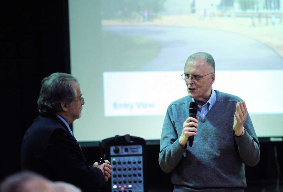 Greenwich resident Bob Tuthill, right, speaks during the presentation given by by Ryszard Szczypek, left, of Tai Soo Kim Partners Architects, of the plans for the new New Lebanon School at New Lebanon School in the Byram section of Greenwich. Photo: Bob Luckey Jr. / Hearst Connecticut Media / Greenwich Time
