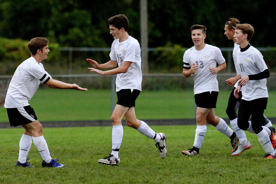 Bullock Creek's Brady Linton, center, celebrates his goal with teammates, from left, Josh Prybyski, Zane Keller and Max Griese Standish-Sterling during the first half on Monday at Bullock Creek High School. Photo: Nick King/Midland Daily News