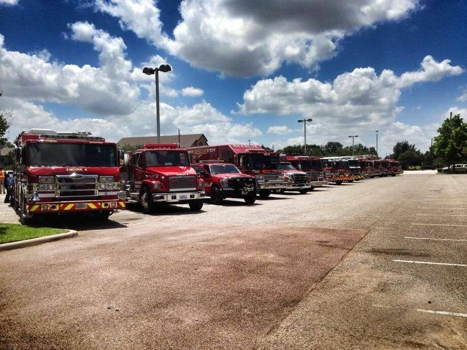 Cy-Fair Volunteer Fire Department service vehicles lined up in a parking lot. Photo: Joe Bell