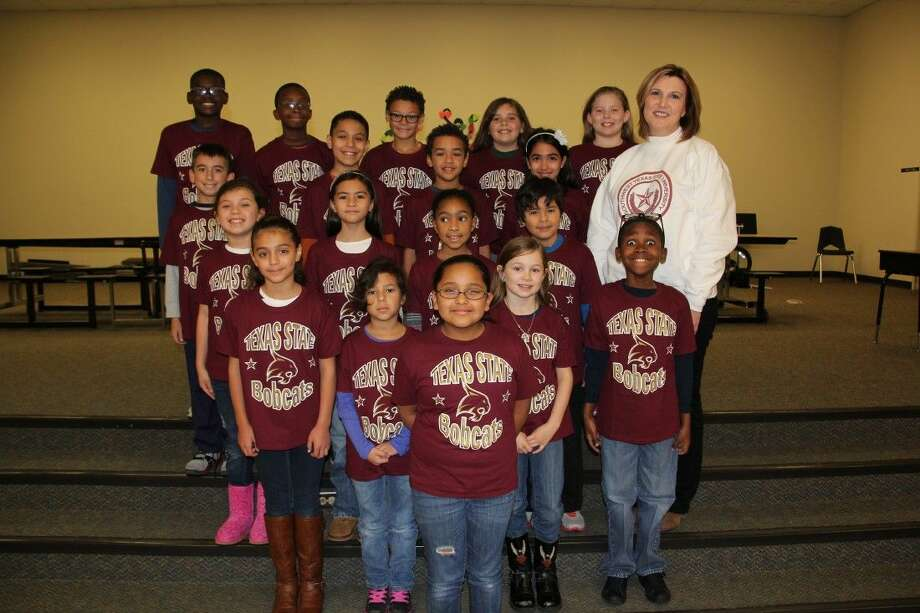 """Elementary students wearing their college T-shirts courtesy of the """"No Limits University"""" project. Photo: Submitted Photo"""