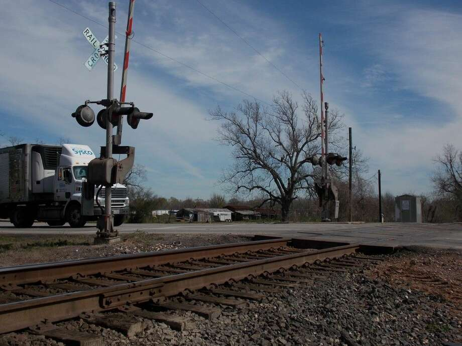 Railroad tracks cross the intersection of FM 359 and 90A in Richmond. The proposed project would build an elevated interchange
