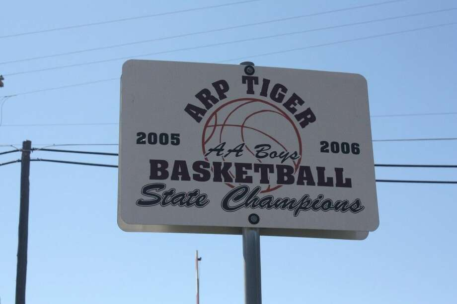 In the little town of Arp, this sign near the main intersection, provides a daily reminder to a basketball state title. Photo: Robert Avery