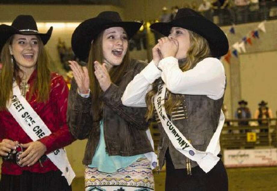 Keely Wilson from Oak Ridge High School and Mykayla Mullins from Caney Creek High School clap for Dayle Anne Krauskopf from Conroe High School as she wins this year's Montgomery County Fair Queen crown during the Montgomery County Fair and Rodeo in Conroe Saturday. To view or purchase this photo and others like it, visit HCNpics.com. / The Conroe Courier/ The Woodlands Villager