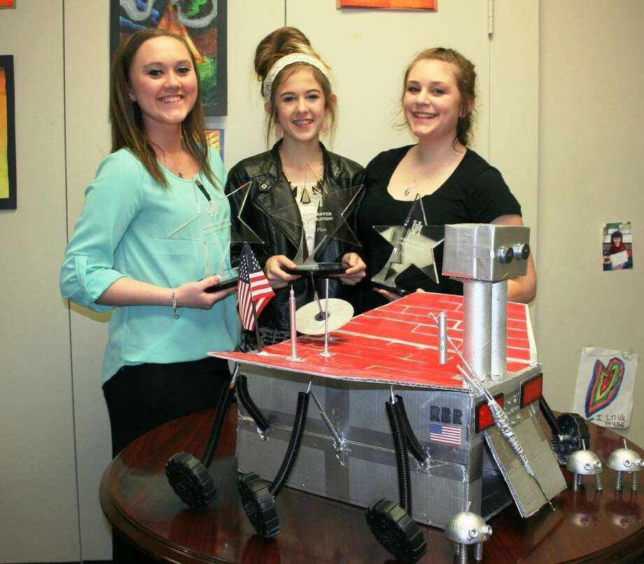 Keefer Crossing Middle School students Lauren Davis, Sophie Wyatt and Taylor Kennedy have won the University of Houston Mars Rover contest three times in a row as of after a recent competition. Photo: Stephanie Buckner