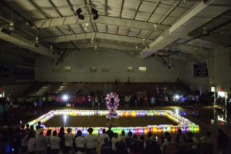 During this year's Relay for Life, held on April 4, luminaria bags lit up the Dayton High School gym in remembrance of loved ones who have passed away from cancer. Photo: ANDREW BUCKLEY