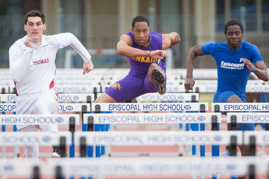 St. Thomas Landon Malouf, Kinkaid's Kamil Lawal, and an Episcopal runner battle it out Friday afternoon during the 110-meter hurdles competition at the Dick Phillips Relay at Episcopal HIgh School. Episcopal won the meet by five points over St. Thomas. Photo: Kevin B Long