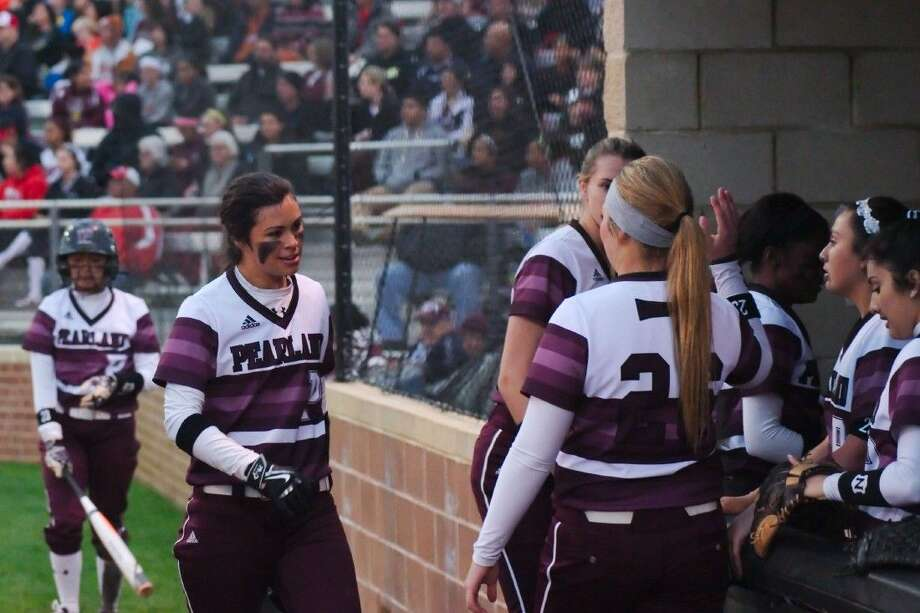 Pearland's Sydney Gutierrez (10) is congratulated by teammates after hitting a two-run home run against Dawson Tuesday night. Photo: KIRK SIDES