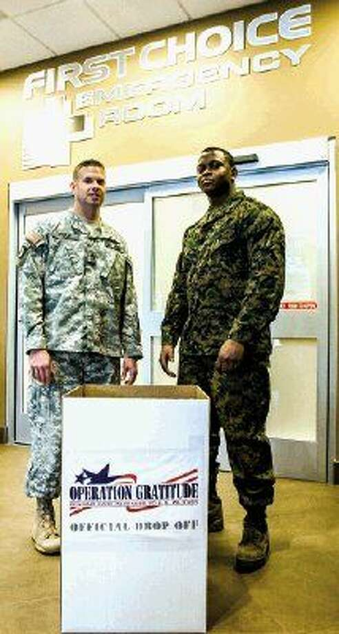 Pictured from left to right are Robert Eudy, staff sergeant, U.S. Army and Christopher Moses, lance corporal, U.S. Marines.