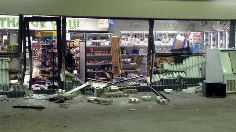 Four suspects on the run after smashing into gas station, stealing ATM in Humble on March 11, 2015.