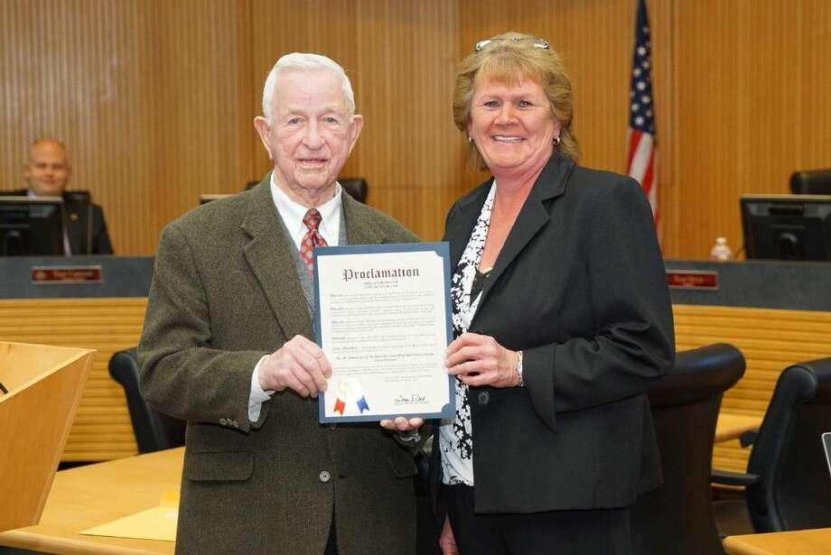 Mayor Tom Reid presents Pearland Campus Principal Jolene McClellan with a Proclamation celebrating 50 years of Head Start in Brazoria County.