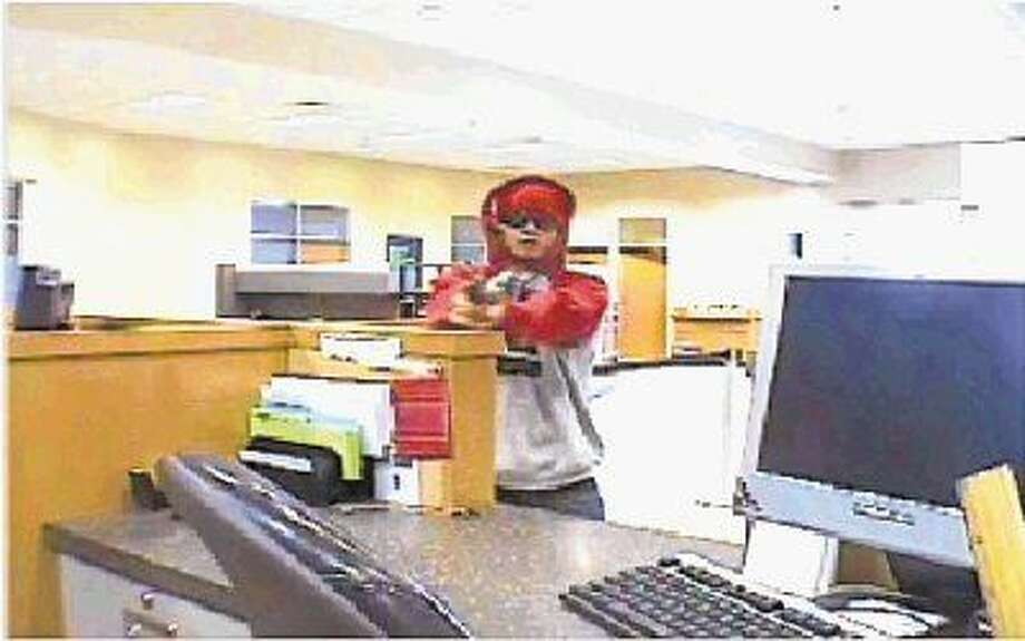 The surveillance photos from the robbery at the Capital One Bank in Humble on Feb. 26, 2016 that allegedly shows the suspect, Ben McClean.