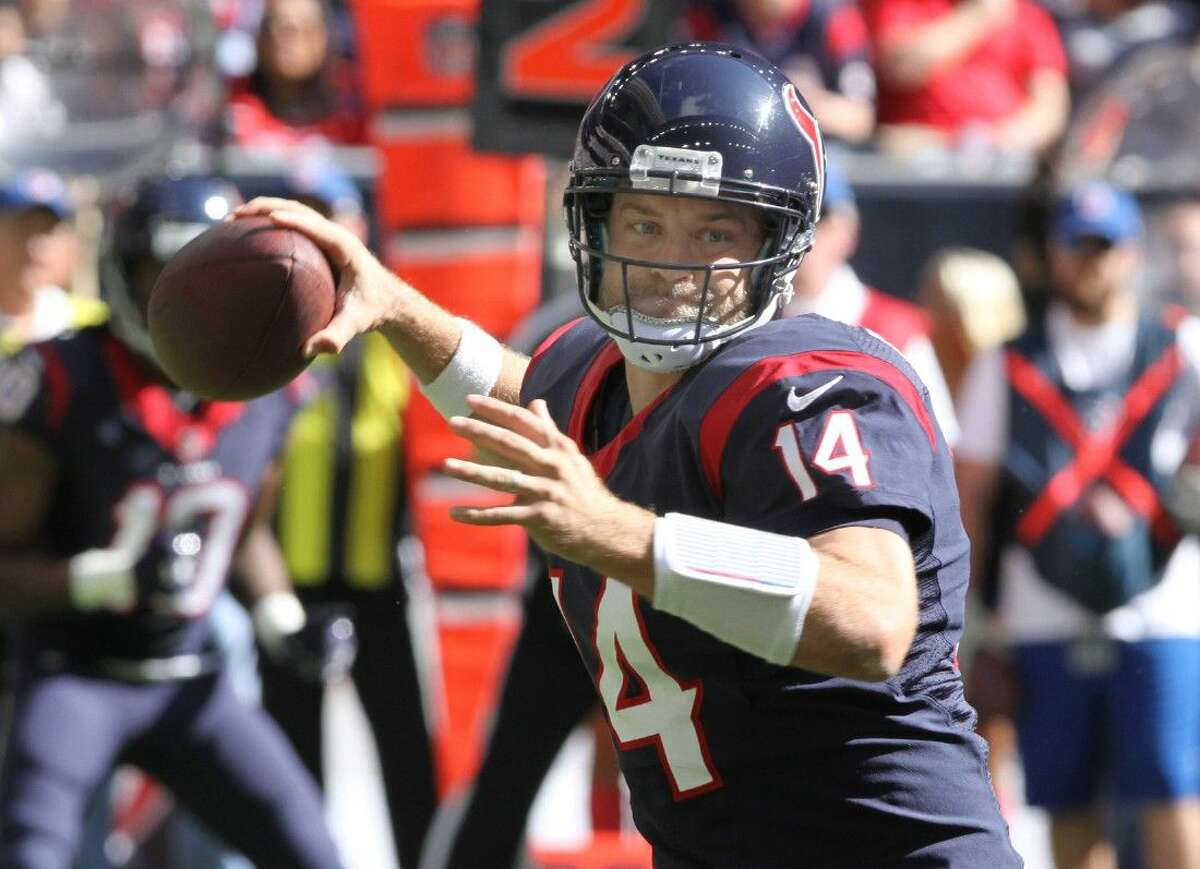 Houston Texans Ryan Fitzpatrick throws against the Tennessee Titans at NRG Stadium in Houston, Texas on Sunday, November 30, 2014. Fitzpatrick had six touchdown passes against the Titans.