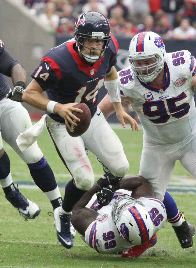 Houston Texans quarterback Ryan Fitzpatrick scrambles against the Buffalo Bills at NRG Stadium in Houston, Texas on Sunday, September 28, 2014. Photo: Staff Photo By Alan Warren