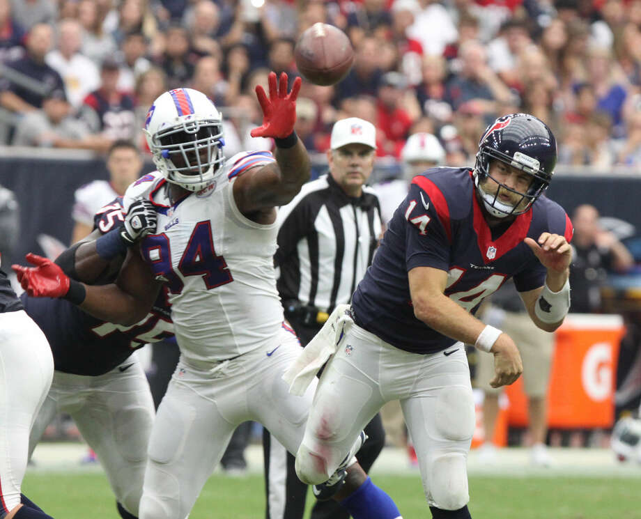 Houston Texans Ryan Fitzpatrick throws under pressure by the Buffalo Bills Mario Williams at NRG Stadium in Houston, Texas on Sunday, September 28, 2014. Photo: Staff Photo By Alan Warren