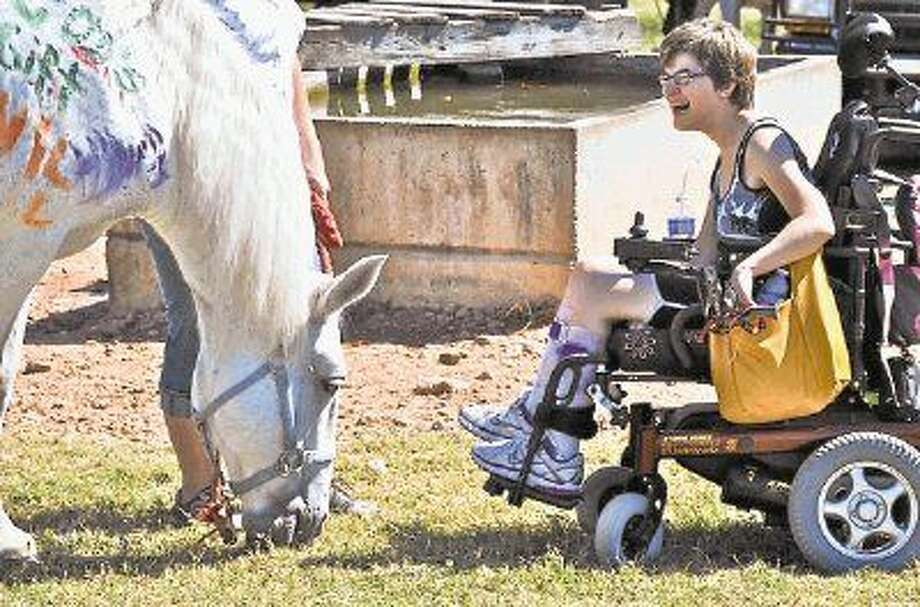 SIRE, an equine nonprofit organization, works to provide a unique form of therapy for residents around the Houston area that have special needs. Photo: Submitted Photo