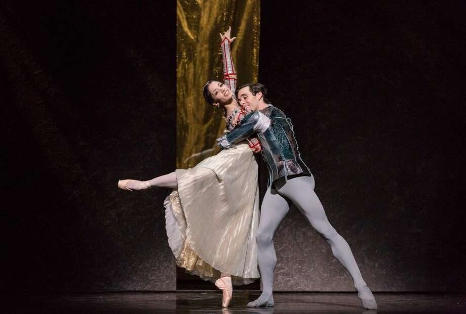 "Pictured are Houston Ballet dancers Karina Gonzalez and Connor Walsh as Juliet and Romeo in Stanton Welch's ""Romeo and Juliet."" The ballet continues through March 8 at the Brown Theater in the Wortham Theater Center in downtown Houston."