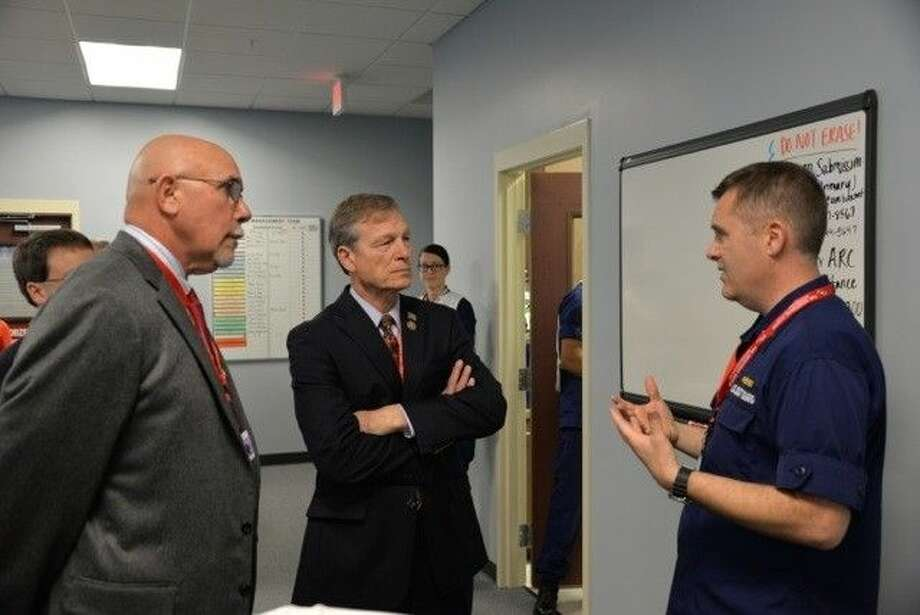 Rep. Brian Babin (center) speaks with U.S. Coast Guard Capt. Brian Penoyer.