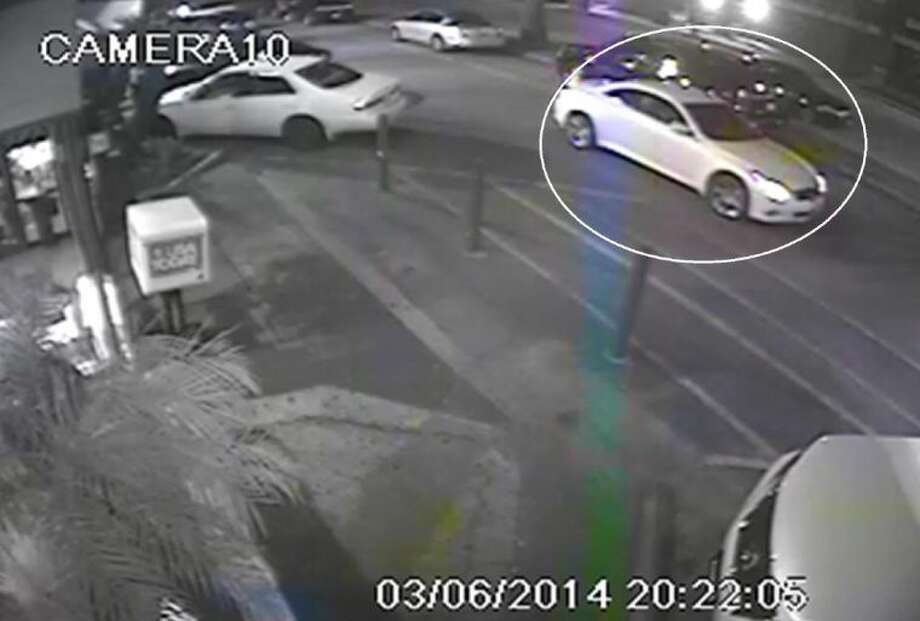 This video frame shows the white Lexus driven by a male that Houston police say is a person of interest in two crimes that occurred March 6 — a fatal shooting at an apartment complex at 8565 West Sam Houston Parkway South and a robbery at the House of Pies, 6142 Westheimer.