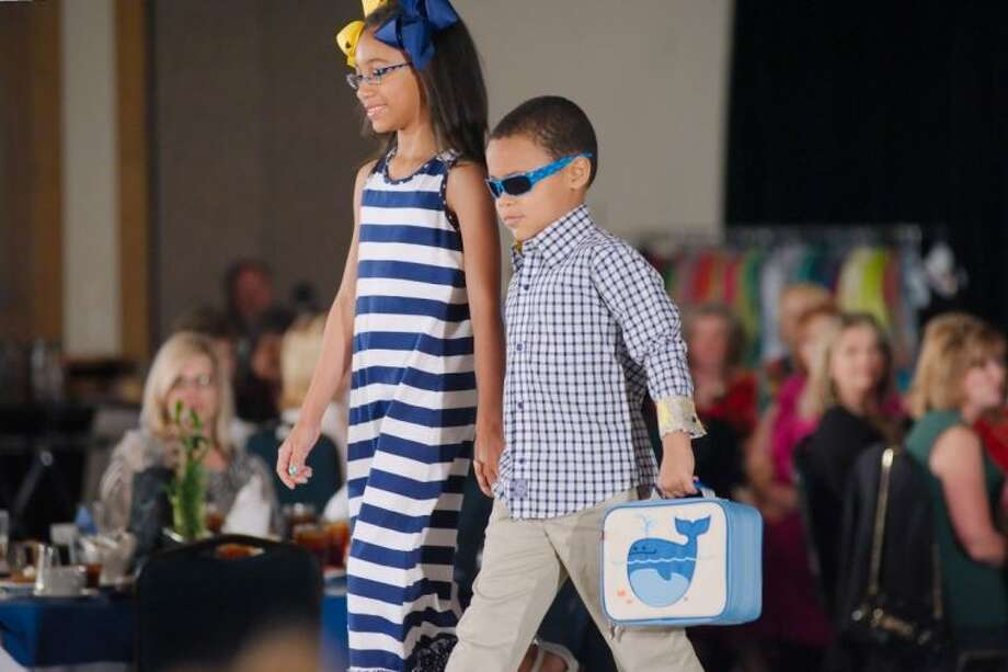Young models show trendy fashions and accessories during the Bridge Over Troubled Waters lunch and fashion show Thursday, April 3. Photo: KIRK SIDES