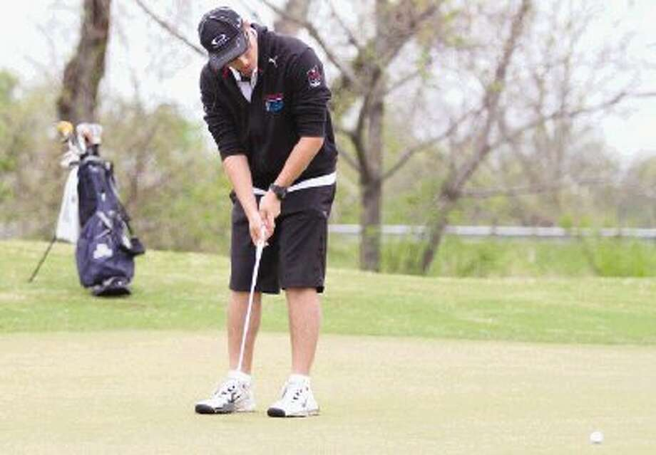 The Woodlands' Steven Schmulson putts on the 12th hole during the District 14-5A boys golf championships in Huntsville. To view or purchase this photo and others like it, visit HCNpics.com. / The Conroe Courier/ The Woodland