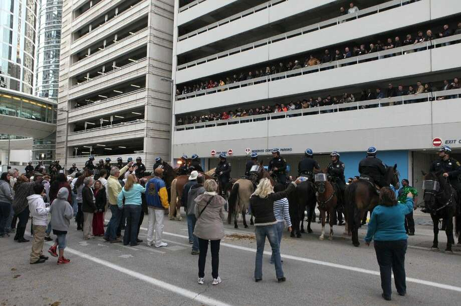 The HPD Mounted Patrol demonstrates a mock crowd management scenarios on the streets of downtown Houston, Texas on Saturday, March 7, 2015. The demonstration was part of a two-day North American Mounted Unit Commander's Association conference, hosted by the Houston Police Department, for mounted units from across the United States and Canada. To view or purchase this photo and others like it, go to HCNPics.com.