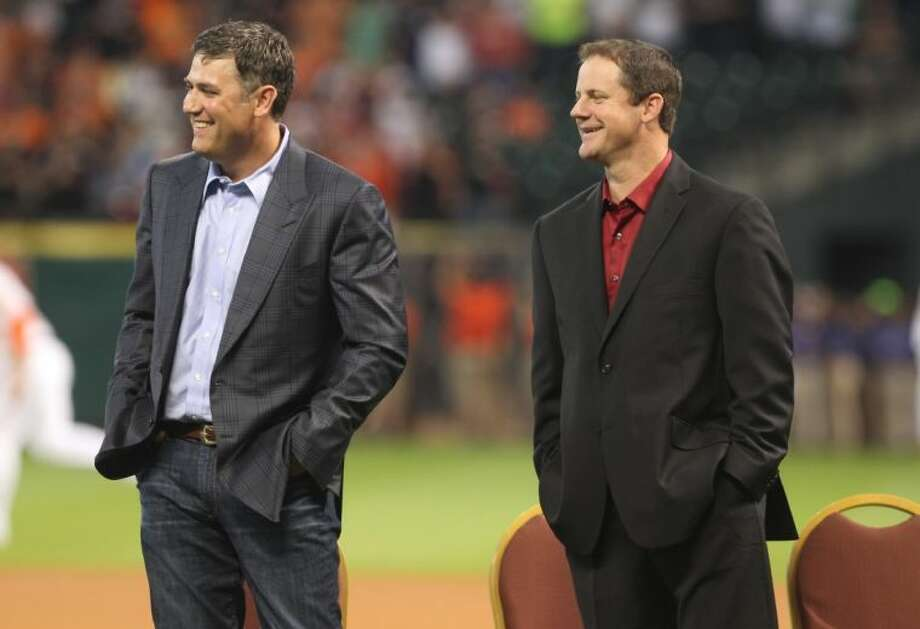 Former Houston Astros players Lance Berkman and Roy Oswalt during a ceremony recoginizing his contributions to the team before a MLB baseball game against the Los Angeles Angels Saturday. Berkman and former teammate Roy Oswalt signed one-day contracts so they could retire as Astros. Photo: Jason Fochtman