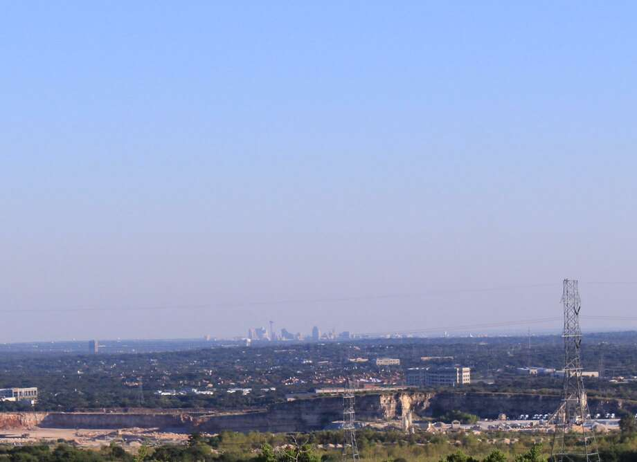 The downtown San Antonio skyline looks hazy from Eisenhower Park on Oct. 2, 2016, the day of a late-season spike in ozone levels. The EPA has said San Antonio is not in attainment on ozone. Photo: Brendan Gibbons / San Antonio Express-News /Brendan Gibbons / San Antonio Express-News
