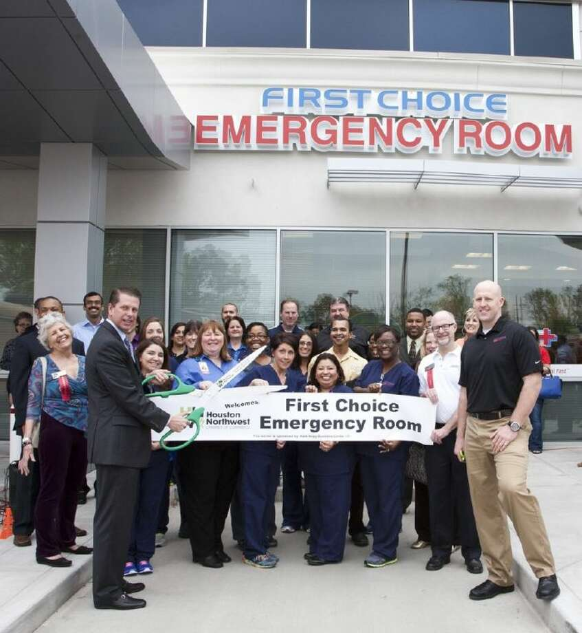 First Choice Emergency Room joins the Cy-Fair and Houston Northwest Chambers of Commerce to cut the ribbon in honor of opening its new facility. Also, First Choice ER presented a donation to the Cypress Creek High School band. Pictured here are First Choice ER Staff and Northwest Chamber of Commerce. Photo: Submitted Photo