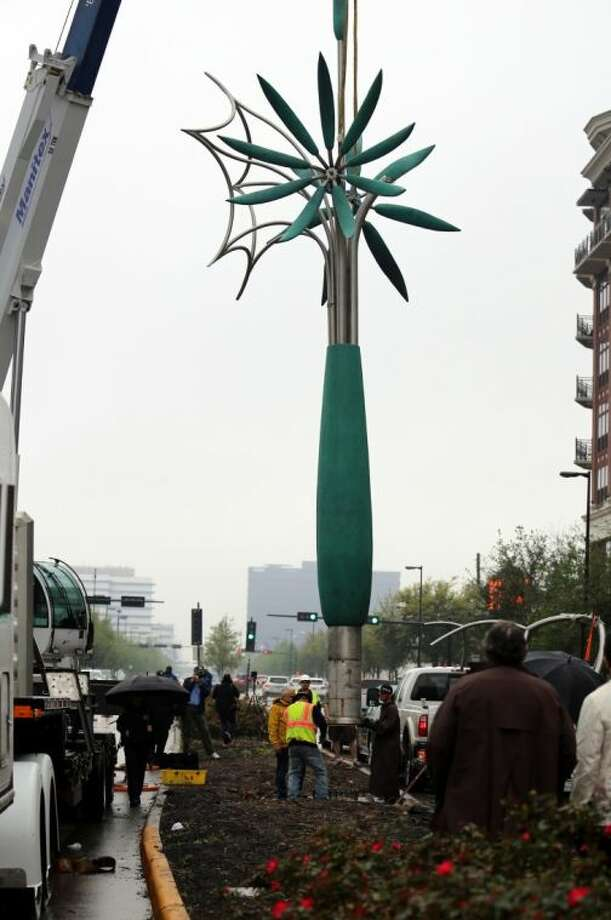 Tree and Three Flowers is lifted by crane Sunday into its base in the median of Kirby Drive, just south of Westheimer. The sculpture was commissioned by the Upper Kirby District and financed through a public/private partnership. Photo: Rusty Graham