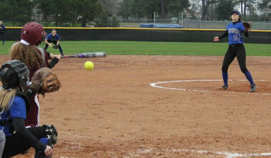 Hillary Jackson (left) of the Lady Horns attempts to hit a pitch made by Lady Pirate Jessica Lyle (right). Photo: Jacob McAdams
