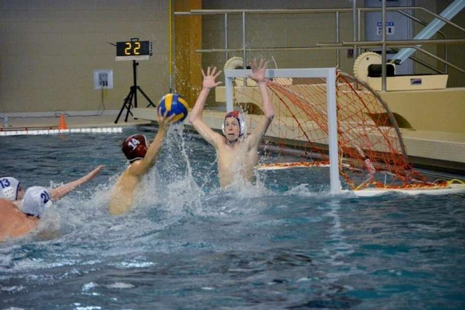 Friendswood's Trey Hamby tries to defend against a shot going into the net in a recent water polo match. Photo: SUBMITTED PHOTO