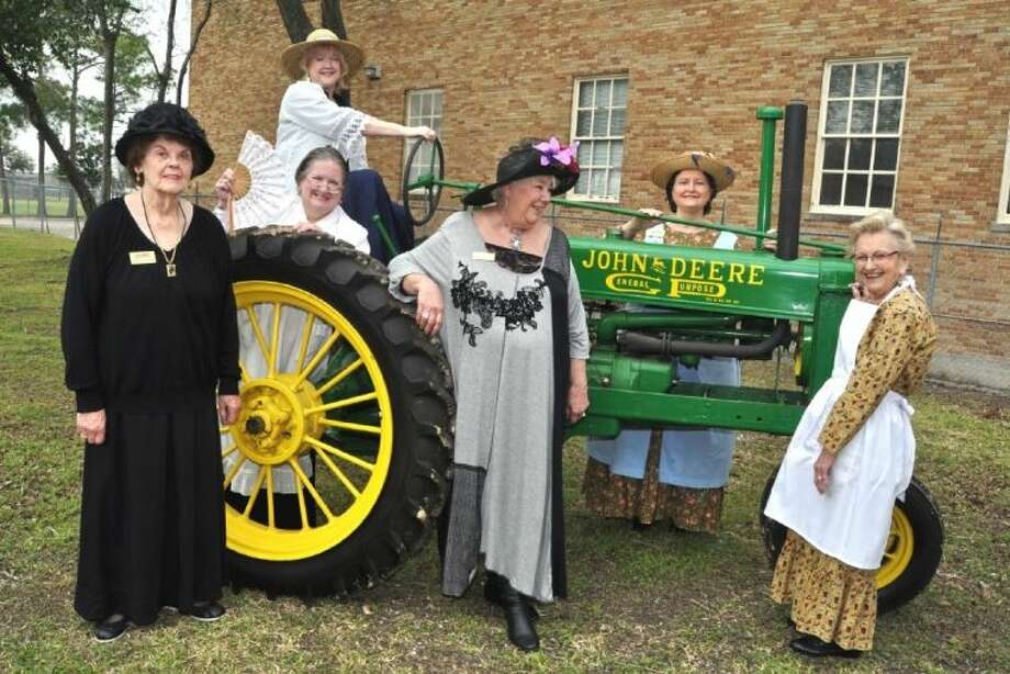 Docents at Heritage Park check out the 1936 John Deere row tractor and planter on loan from Dan Hinton who is an avid tractor collector. Pictured from left, Catherine Carlisle, Carol Arnold, Lucy Turoff, Rosie Richards, Marie Reed and Edna Pierce. Photo: JACKIE WELCH