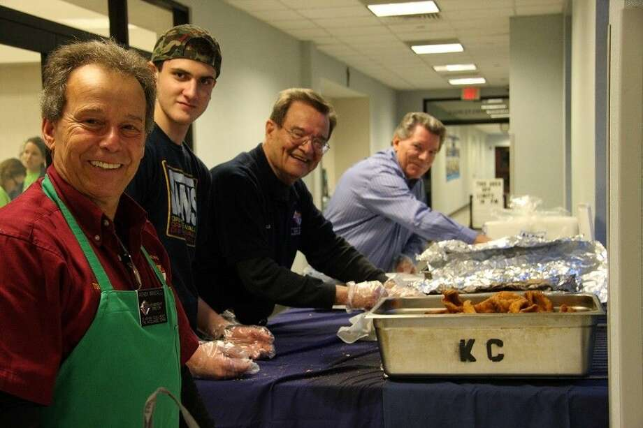 Knights of Columbus Council members prep to-go boxes during a Lenten Fish Fry at St. Anthony of Padua Catholic Church in The Woodlands. The fish fry continues today, next Friday and Sunday, March 22.