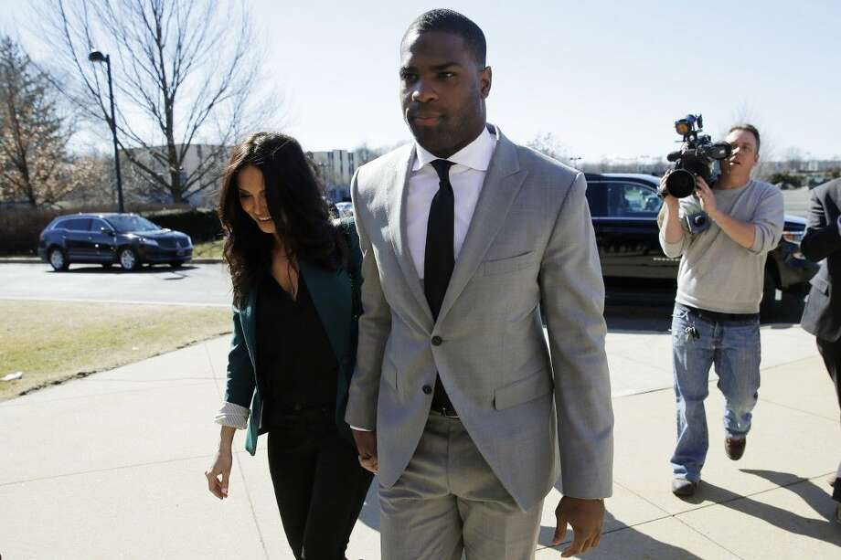 Running back DeMarco Murray arrives with his fiance Heidi Mueller at the Philadelphia Eagles' NFL football practice facility Thursday in Philadelphia.