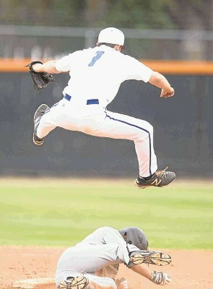 Episcopal second baseman Richard Pickard goes high in the air to avoid a baserunner during a recent Knights' victory. Episcopal is the four-time defending Southwest Preparatory Conference baseball champions and began this week 1-1 in the SPC South Zone with two big games coming up this week, starting Friday in Austin. Photo: Kevin B Long / © Copyright 2012, Gulf Coast Shots, All rights reserved.