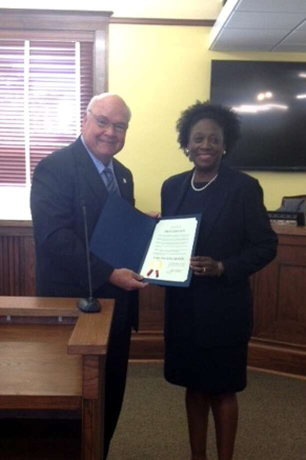Fort Bend County Judge Hebert presenting his proclamation to Fort Bend County Community Development Director Marilynn Kindell at the April 1 meeting of the CommissionersCourt. Photo: Photo Courtesy Office Of The Fort Bend County Judge