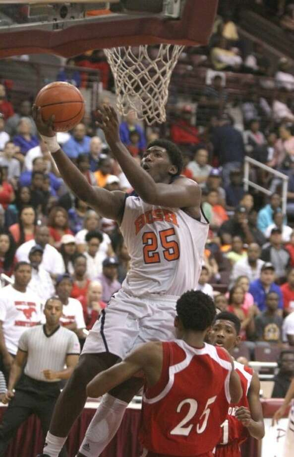 Bush's Brandon Jones drives in for a basket against North Shore during the regional final March 1. Jones was voted District 23-5A MVP. To view or purchase this photo and others like it, go to HCNPics.com. Photo: Alan Warren
