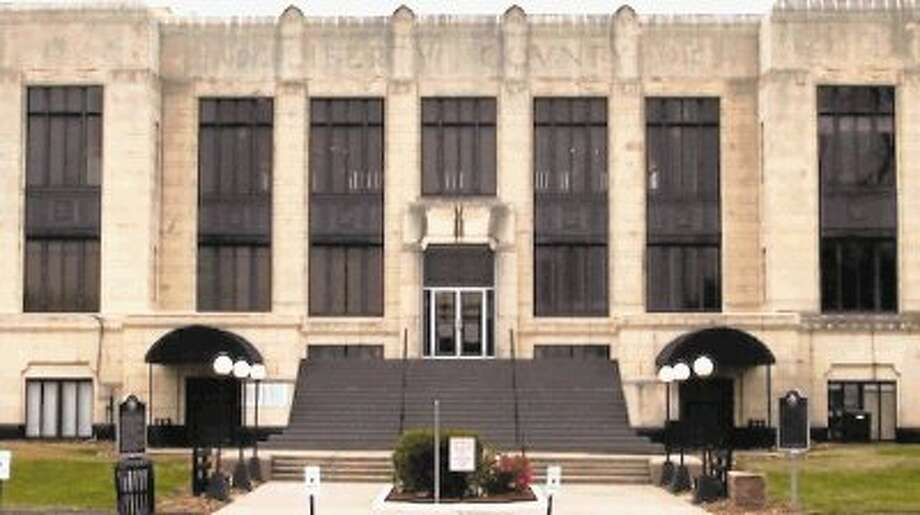Shown here is the south entrance of the Liberty County Courthouse. Commissioners Court regularly meets in the second floor courtroom every other Tuesday morning. Photo: CASEY STINNETT / Houston Community Newspapers, 2014