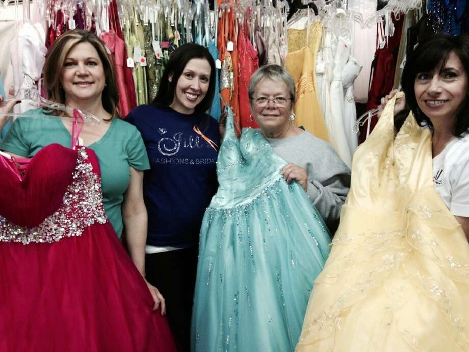 Pictured left to right are Operation Cinderella Vice Chairman Christina Deane, Jill's Fashions & Bridals Owner Danielle Smith, Chairman Ann Hammond and Assistance League President Brunella Altemus.