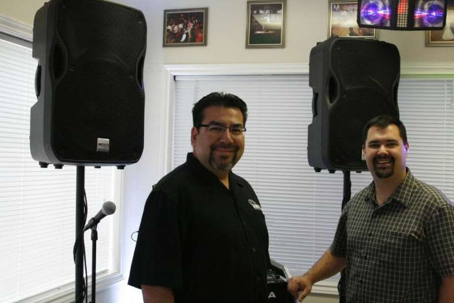 JR Hernandez, left, and Joey Kovacik of DJ Brothers, show off their display room at their new building located in downtown Humble on Main Street.
